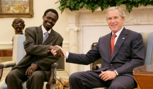 Minni Minnawi, leader of the Sudanese Liberation Movement, shakes hands with George W. Bush on July 25, 2006 in the Oval Office.