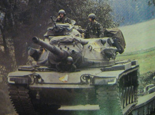 From Air Man, tanks cross a bridge during the war game.