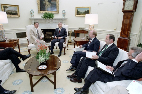 Reagan and Gordievsky center.  Two unidentified men to watch on right.  Carlucci further to the right.  Baker's foot can be seen to the left.  This photo suggests that the two unidentified men are likely British, as it is unlikely any American would sit between the president and his national security adviser.