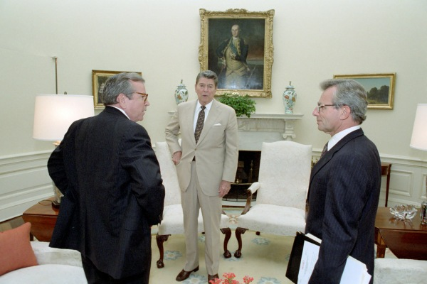 "President Reagan (center) with Chief of Staff Howard Baker (left) and National Security Advisor Frank Carlucci (right).  Notice the ""SECRET"" document Carlucci is carrying."