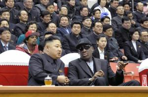 Kim Jong-un and Dennis Rodman catch a basketball game together. KCNA/AFP/GETTY IMAGES