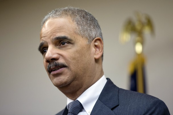 AG Holder has announced the DOJ will not offer Snowden clemency, is seeking billions in penalties and damages from the contractor that performed his background check. Photo: Matt Rourke/AP