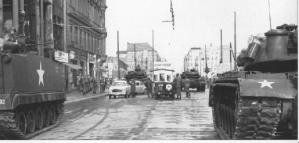 Tension mounted in late October 1961 when the Soviets mistakenly concluded that U.S. tanks deployed at Checkpoint Charlie signaled an effort to break through the wall. Moscow deployed 10 tanks which squared off with the U.S. tanks. Kennedy and Khrushchev privately defused the situation by agreeing that the Soviet tanks would withdraw first. (Photo source: U.S. National Archives, Army Signal Corps Collection, #111-SC-591491)