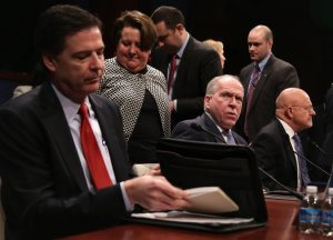 CIA director John Brennan sits between FBI head James Comey, and director of national intelligence, James Clapper. Photo: Alex Wong/Getty Images