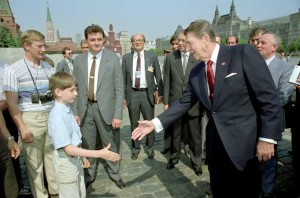Reagan and, according to past and present White House photographer  Pete Souza, Vladimir Putin in Red Square; 1988.