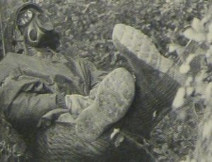 "A soldier takes a break (in a gas mask) during the Reforger 83 ""military movement"" (not ""maneuver!)""  From Air Man."