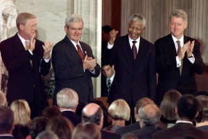 Nelson Mandela welcomed by President Bill Clinton and Speaker Gingrich at a 1998 ceremony where Mandela received the Congressional Gold Medal - while he was still on the terror watch list. Photo: Ruth Fremson/Associated Press