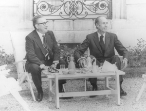 Secretary of State Kissinger meets with French President Valerie Giscard d'Estaing, over coffee and a plate of croissants, on 5 July 1974. The French government's support was critical to the success of the nuclear suppliers' project. Photo from Still Pictures Branch, National Archives, RG 59-BP, box 36.
