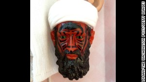 The bin Laden doll after the top layer of paint faded away. Photo by Adam Goldman/The Washington Post