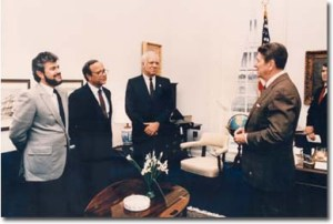 President Reagan meets with Contra leaders in the Oval Office. Oliver North is at far right. When this photo was officially released North's image was cut out.
