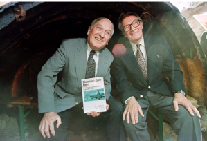 Former CIA officer David E. Murphy, left, and former KGB officer Sergei A. Kondrashev pose in 1997 at the exit of an espionage tunnel in Berlin. (Reuters)