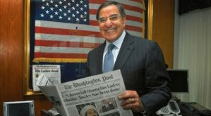 Leon Panetta holds a copy of The Washington Post reporting Osama bin Laden's death. Courtesy of the Panetta Institute