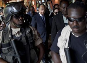 Jean-Claude Duvalier escorted by police upon his return to Haiti in 2011. Photo credit: Ramon Espinosa/AP
