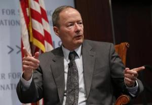 Former NSA director Alexander, seen here in a panel discussion at the Center for Strategic and International Studies (CSIS) in Washington, June 2, 2014, did everything right but is going to stop doing it anyway because he might get in trouble...Photo Credit: REUTERS/YURI GRIPAS