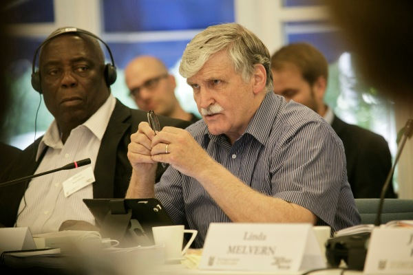 Lieutenant General Roméo Dallaire (center), the Force Commander of the United Nations Assistance Mission for Rwanda (UNAMIR), recalls his experience as a peacekeeper and what it was like to be tasked with implementing the 1993 Arusha Peace Accords, as his Deputy, Major General Henry Anyidoho (left), looks on.