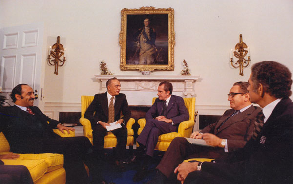 "Nixon and Kissinger Meet with Four Arab Foreign Ministers, 17 October 1973: Ahmed Taiba Behima (Morocco), Sabah al-Ahmad al-Jabir al-Sabah (Kuwait), Omar Saqqaf (Saudi Arabia), and Abdelaziz Bouteflika (Algeria). Saqqaf is Nixon's right. The other two ministers have not been identified, while one of the four was not included in this photo. Source: National Archives, Still Pictures Branch, Nixon Presidential Materials Photo Collection, file ""Diplomatic"""