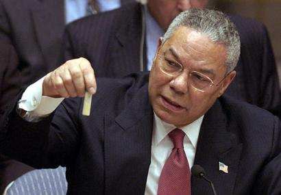 U.S. Secretary of State Colin Powell holds up a model vial of anthrax during his historic presentation before the United Nations Security Council, February 5, 2003. (Image extracted from a video available from the White House Web site.)
