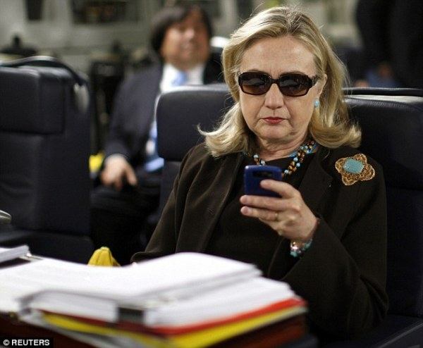 Hillary Clinton with the Blackberry the State Department did not give her.