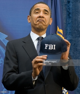 Don't blame the President for making this face in 2009 after then-FBI director Mueller gave him this hat as a gift. AFP PHOTO / Saul LOEB
