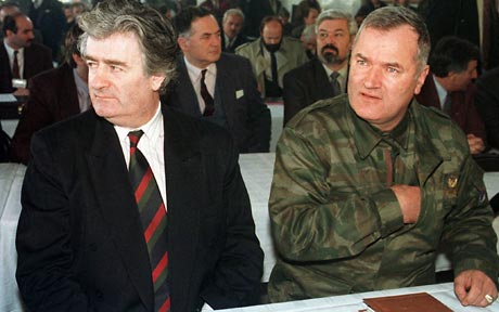 Radovan Karadžić (left) with former Bosnian Serb military leader Ratko Mladić, who is currently on trial before the ICTY. AP photo.