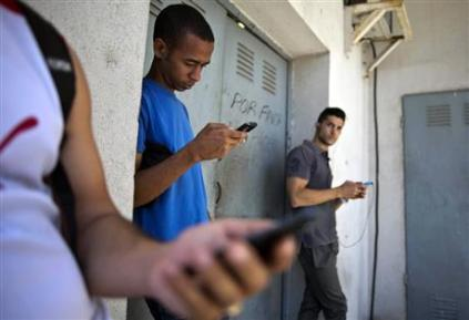 Students on their phones in Havana. AP Photo/Ramon Espinosa, File,