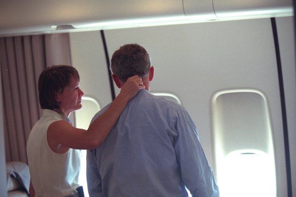 "One of the FOIA-released photos shows the president being ""consoled by Lt. Col. Cindy Wright of the White House Military Office aboard Air Force One. After leaving Louisiana, the president was flown to Offutt Air Force Base in Nebraska before he headed back to Washington D.C."""