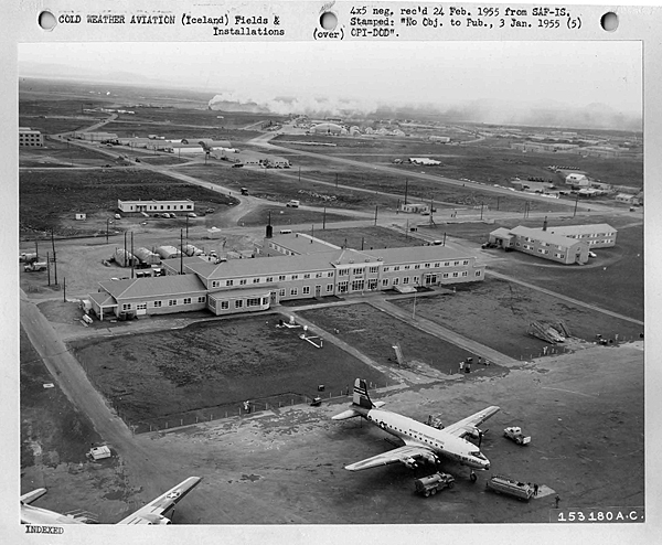 """From the original Air Force caption: """"A view of the famous Terminal Hotel at Keflavik Airport, Iceland, is pictured here. In the foreground are two MATS [Military Air Transport Service] aircraft parked out front of the hotel."""" (National Archives, Still Pictures Branch, RG 342-B, box 1458, Foreign Locations—Iceland)"""