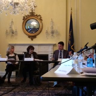 Nate Jones (R) speaking at the most recent FOIA Advisory Committee meeting. OGIS's Nikki Gramian is center, and OIP's Melanie Pustay is on the left.
