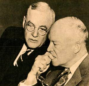 "President Dwight D. Eisenhower (right) with Secretary of State John Foster Dulles: architects of a foreign policy identified with rhetorical calls for anti-Communist ""rollback"" but characterized more accurately by James Conant's famous dictum to ""keep the pot simmering."" (Photo credit: unknown)"