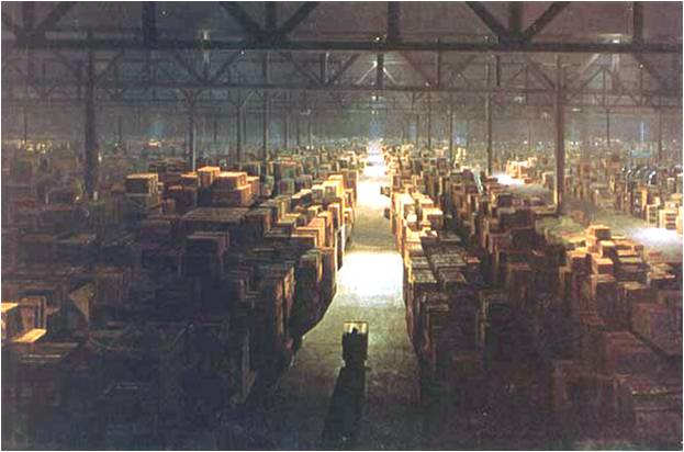 Image of warehouse from Indiana Jones movie, with boxes stacked on either side of a long aisle.